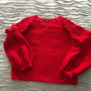 Warm elegant sweater with bell sleeves.